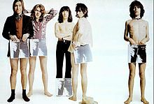 The Rolling Stones posing in an ad with the artwork from Sticky Fingers in 1971, from left to right: Charlie Watts, Mick Taylor, Bill Wyman, Keith Richards, and Mick Jagger