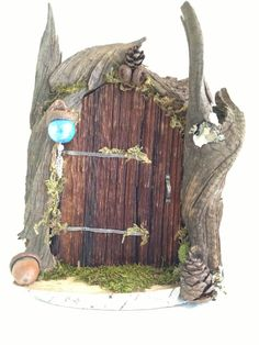 Handmade driftwood fairy door by BlackSquirrelStudios on Etsy, $30.00