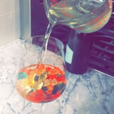 """Getting ready for my New Years pajama party tomorrow making champagne soaked """"drunken"""" gummy bears ----- recipe is so easy: 2 cups gummy bears, 3 cups champagne or sparkling wine. Soak gummy bears in champagne for 10-12 hours in refrigerator and enjoyyyyy"""