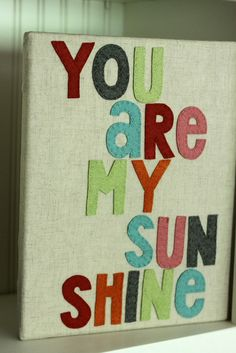 Felt letters on canvas by L Poel, via Flickr