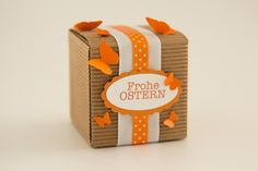 Osterdekoration für Geschenkschachtel in orange. www.der-schachtel-shop.de