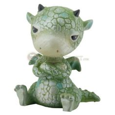 Green Sulky Dragon. www.teeliesfairygarden.com . . . This green dragon is sulking over his ice cream! The naughty gnomes ate it. #dragons