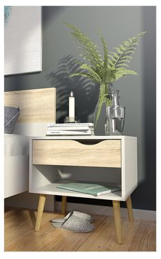 Oslo Bedside Table - a classic design with a modern interpretation. The bedside table features a storage compartment and a drawer with a cut-out front handle. The legs are made of solid oak wood. Oslo, Modern Rustic Interiors, Mid Century Style, Mid-century Modern, Bedroom Decor, Craft, Home Decor, Furniture Outlet, Online Furniture
