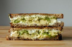 The Cure-All - scrambled eggs, arugula pesto, goat cheese, and buttery wheat bread