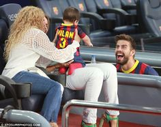 Doting dad: Gerard Pique, 27, looked overjoyed as he ogled at his son Milan Pique and his better half Shakira
