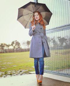polka dot coat and jeans in the rain