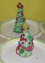 2nd & 3rd garde food craft table- Christmas tree craft. For each class need: 1 bag Christmas colored  M's, 1 bag or box of Red hots, 1 bag Pull apart twizlers, 1 bag of gumdrops, 2 or 3 Green frosting & sugar cones 20ct
