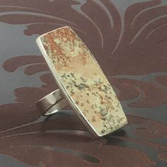 A unique dendrite stone set in a sterling silver frame perfect for your boots and jeans look. Emerald Jewelry, Gold Jewelry, Unique Jewelry, Sterling Silver Jewelry, Silver Rings, Tan Shoes, Jewelry Collection, Stone, Stuff To Buy