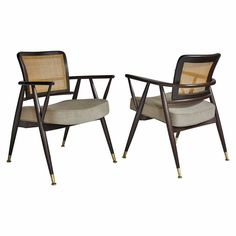 Pair of Cane-Back Midcentury Armchairs   From a unique collection of antique and modern armchairs at https://www.1stdibs.com/furniture/seating/armchairs/