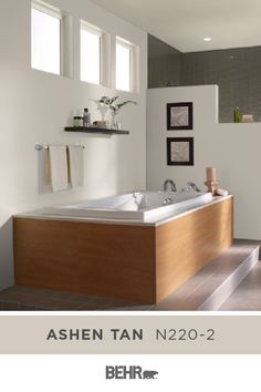 Sink into the warm and relaxing hue of BEHR® Paint in Ashen Tan. We're loving the way this warm, neutral wall color comes together with the wood tones in the master bathroom—creating a spa-like style. Click below for full color details to learn more.