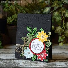 comfort card by Connie Collins... love the pop of colors on black embossed base
