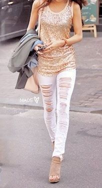White ripped jeans and a sequin top. Too cute :)