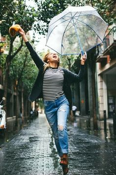 Young woman holding an umbrella jumping on the street. Rainy Day Photography, Rain Photography, Autumn Photography, Photography Women, Portrait Photography, Photography Ideas, Walking In The Rain, Singing In The Rain, Photos Of Women