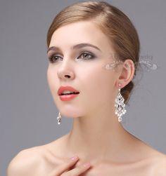 Bridal chandelier earrings, Wedding Earrings ,Rhinestone White Ivory Pearls Sterling Silver Studs Wedding crystals Earrings,Bridal Jewelry by adriajewelry on Etsy https://www.etsy.com/listing/118692114/bridal-chandelier-earrings-wedding