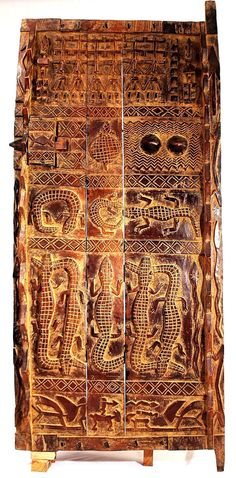 Africa | Carved wooden door from the dogon people of Mali.