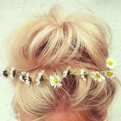 Blonde, messy bun with flowers in hair