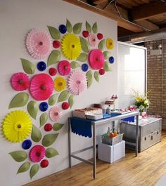 paper fans and leaves make an impressive temporary wall decoration for a themed party . . .