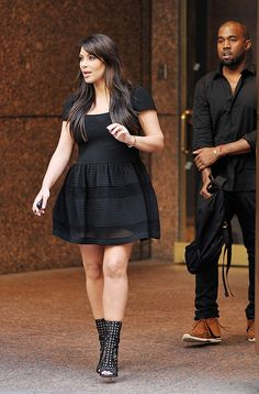 We've seen this look before! Kim wears a black �Azzedine Alaia dress, very similar to the nude dress worn to visit