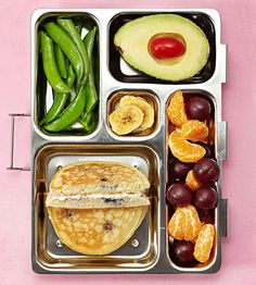 Turn lunch into brunch with a blueberry-pancake sandwich with cream-cheese filling, sugar-snap peas, an avocado half with cherry tomato, banana chips, clementine sections, and grapes.