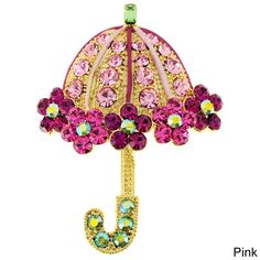 This fun lady's umbrella pin is available in your choice of goldtone with pink crystals or black-plated with purple crystals. A classic pin secures this antiqued brooch.