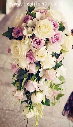 teardrop bridal bouquet - purple and white roses
