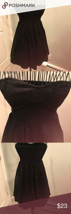 Topshop strapless black dress elasticized top S Black viscose. Sweetheart neck. Elasticized gathering thought bodice so is stretchy.   corset type  stitching. Fuller skirt. Unlined. Very good condition Topshop Dresses Strapless