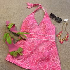 HOST PICK Lily Pulitzer halter top Adorable pink floral cotton halter top with striped detail on the band below the bust. A structured Bobis to give you support without a bra. Excellent excellent condition! Lilly Pulitzer Tops
