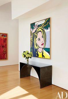 In the foyer, Roy Lichtenstein's 1965–66 painting *I . . . I'm Sorrysurmounts* Scott Burton's steel Semi-Circle Table, 1993