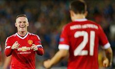 Wayne Rooney celebrates his third goal with Ander Herrera.