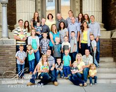 Large Family pose with stairs.  http://ambervestphotography.com/