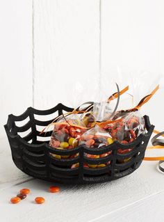 This soft felt basket featuring a spiderweb-inspired cutout design is the perfect way to serve whatever creepy snacks you have in store for your Halloween party.