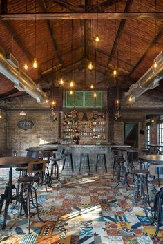 "Completed in 2015 in Assagao, India. Images by Harshan Thomson Photography. ""Soro"", meaning alcoholic beverage in Konkani is a tavern conceptualised within the ruins of an old corner store.  The corner store itself became the..."