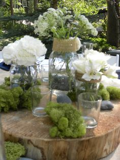 Tree stumps and mason jars with Queen Anns Lace for centerpieces