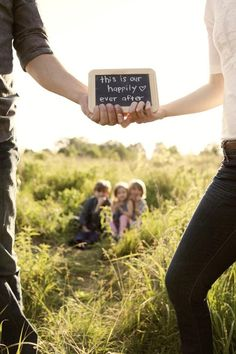 Cutest Idea Ever. Family photo children mum and dad Chalk board cute saying outdoors sunshine field paddock grass