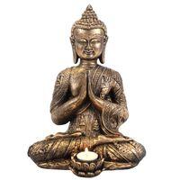Rustiikkisen kullansävyinen istuva buddhapatsas, jossa on paikka tuikulle (halkaisija noin 44mm). Mitat 33*23*19 cm. Valmistusmateriaali resin.