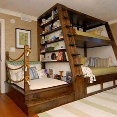 Nautical themed bunk bed with sofa and bookshelf- what a great use of space!