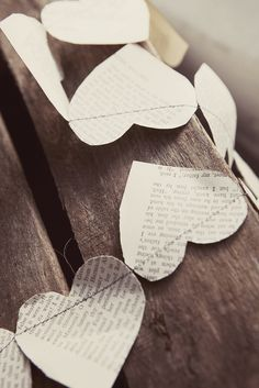 How fun would this be dipped dyed!? It would take a ton of patience but it would be worth it! // paper print hearts / newspaper hearts / valentines garland