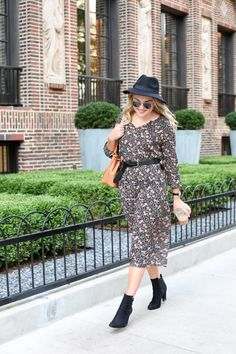 Bows & Sequins wearing an Old Navy hat, a floral print dress, Kate Spade watch, Madewell leather belt, and ankle booties.