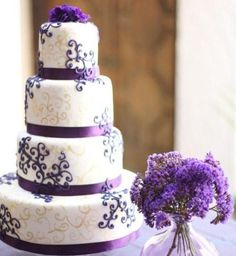 Purple Wedding Cake - something about scrolls over the ribbon...