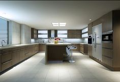 A spacious and modern kitchen with skylights and frosted, top-hinge cabinets.