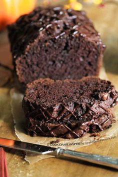 Triple Chocolate Bread! A rich chocolatey quick bread with a secret ingredient to keep it extra moist! This loaf contains dessert & breakfast all in one!