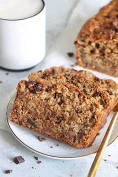Vegan Chocolate Chunk Banana Bread that's 100% whole grain, perfectly sweet and moist, and takes less than 10 minutes to whip up! A healthy banana bread recipe that will quickly become a favorite.