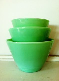 Very Hard To Find Fire King Oven Ware Jadite Jadeite Glass Splash Proof Mixing Bowls Nesting Set of 3. $350.00, via Etsy.