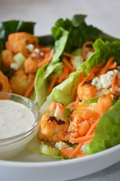 Buffalo chicken goes plant-based with these tasty buffalo cauliflower lettuce wraps. All your favorite buffalo wing flavors - buffalo sauce, celery, carrots and blue cheese - get wrapped up for a crowd-pleasing appetizer. Cauliflower Wings, Buffalo Cauliflower, Healthy Appetizers, Appetizer Recipes, Buffalo Recipe, Fruits And Veggies, Vegetables, Game Day Food, Lettuce Wraps