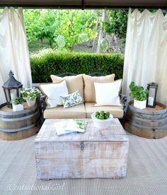 DIY outdoor lounge using old wine barrels