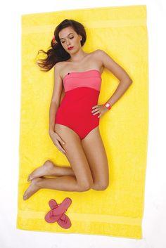 Cruise 2013 Swim Trend: Sun Block  (Lolë's nylon and elastane swimsuit. Jennifer Behr hair comb; Neff watch; Tkees sandals.)