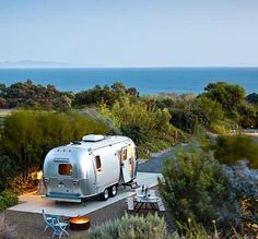 buy small land next to the sea and don't build anything, just buy an airstream, oh my what a dream!