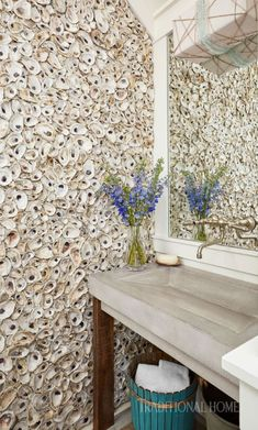 Tabby walls crafted of oyster shells combine with a contemporary concrete sink. - Photo: Jean Allsopp / Design: Georgia Carlee