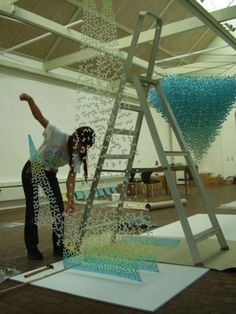 Yuko Takada Keller - Often inspired by the afterimages of her dreams, artist Yuko Takada Keller creates visually striking paper sculptures that cascade from the ceiling...