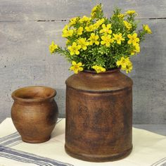 """This large brownvintage-style stoneware crock has an aged finish, perfect or a farmhouse kitchen. Display a bunch of daisies or mini berries to bring a bright spot of color to your country home.Measures: 8""""H x 6""""Dia(Shown on right)"""